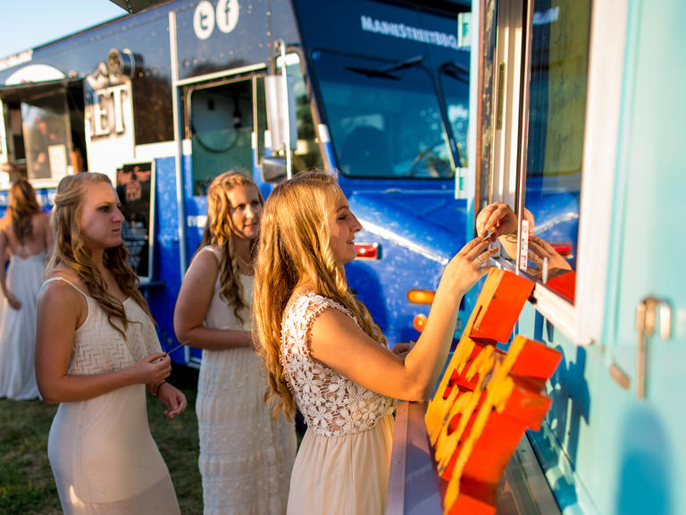 Food trucks offering catering at a wedding