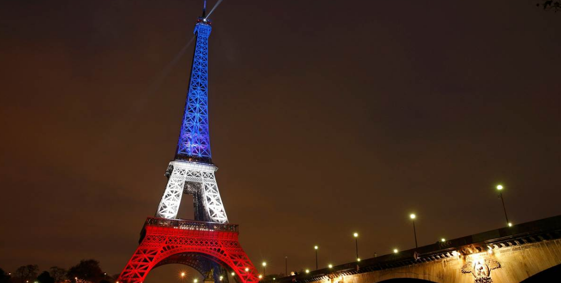 Eiffel Tower illuminated with the French colors after terrorist attacks